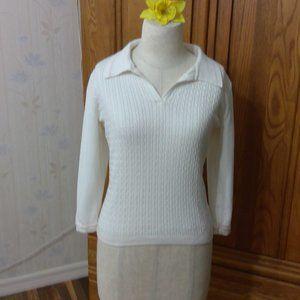 White Tommy hilfiger tennis sweater.